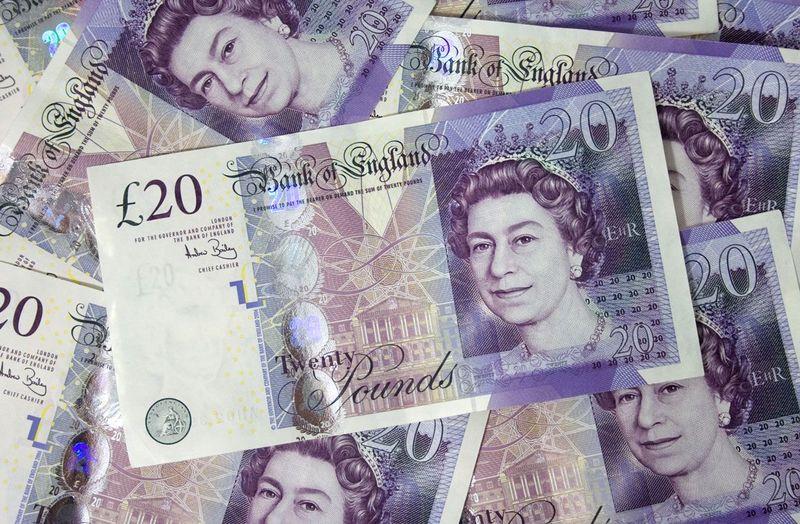 Several-pound-bills-new-british-20-pounds-money